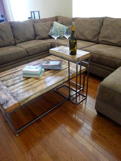 R coffee table and C table industrial reclaimed wood and welded metal table legs rustic furniture and minimalist interior design.