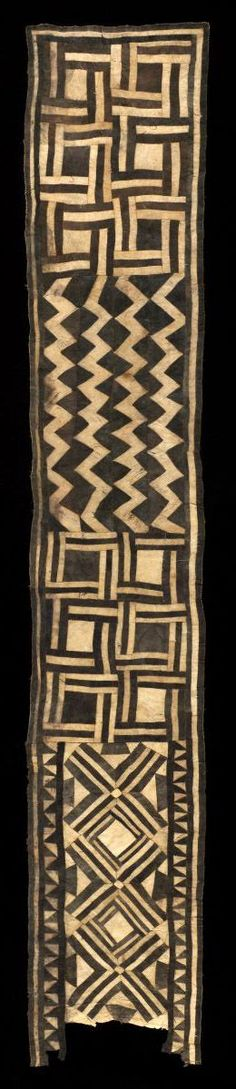 Africa | Woman's Ceremonial Skirt from the Bushong people of DR Congo | ca. early 20th century | Pounded and dyed inner bark (Ficus); piecing | This striking wraparound skirt was made for an aristocratic woman of the Bushong ruling group, possibly a member of the royal clan, since they were the only Kuba who were entitled to wear barkcloth, which was otherwise restricted to mourning and funerary rite.: