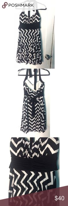 Black And White Chevron Dress Never been worn black and white chevron patterned dress. Great for school dances & formal events! Speechless Dresses Midi