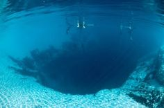 The Great Blue Hole is an underwater sinkhole off the coast of Belize. The hole is 1,000 feet across and 400 feet deep. It was formed as a limestone cave during the last ice-age.
