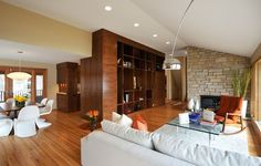 Mid century modern - love the use of white and rust against the paneling color