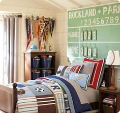perfect little boy's room! Maybe take those  pennants hanging in the corner and make them into a window treatment?!
