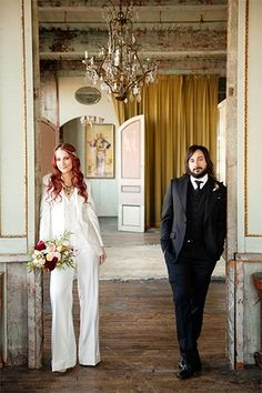 """Should A Bride Wear A Suit On Her Wedding Day? (Um, Obviously!) #refinery29  http://www.refinery29.com/martha-stewart-weddings/2#slide-1  Hayley and Gregg both sported custom suits by Amber Doyle at Against Nature. """"We commissioned bespoke suits inspired by '70s-era 'it couple' Mick and Bianca Jagger to help carry over our theme."""" Hayley's bouquet included red charm peonies, chocolate cosmos, Pieter B roses, ranunculus, Sally Holmes roses, and forsythia.  Bride and Groom's Suits: Amber…"""