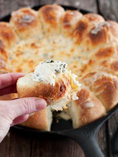 Warm Skillet Bread and Artichoke Spinach Dip - A skillet full of delicious. Warm pull-apart rolls around a center of creamy artichoke and spinach dip. Perfect for game day or holiday entertaining | Seasons and Suppers
