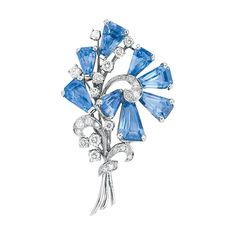 Platinum, Sapphire and Diamond Brooch, Oscar Heyman Bros.   The stylized flower embellished by 8 kite-shaped sapphires approximately 13.68 cts., accented by 26 round diamonds approximately .96 ct., signed OHB, #48098, circa 1954, approximately 9 dwt.