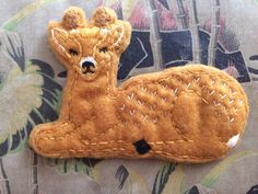 Cute felt woodland deer brooch. Hand crafted from my own design. Safety pin fastening.