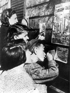 Lodz, Poland, Children copying weekly food ration details from the bulletin board, 13-16/06/1941.