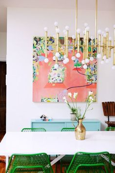 Colorful dining room decor // dream home // turquoise credenza, green chairs, gold light fixture. Pink art