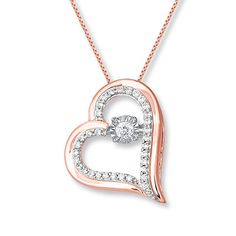This lovely heart necklace from the Diamonds in Rhythm® collection features a specially set round diamond at the center that shimmers as it moves. Additional round diamonds decorate the heart frame, styled in 10K rose gold. The necklace has a total diamond weight of 1/4 carat. The pendant sways from an 18-inch box chain that secures with a spring ring clasp. Diamond Total Carat Weight may range from .23 - .28 carats.