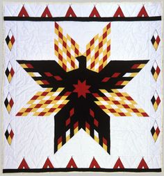 Thunderbird Star, c.1991  Rita Corbiere (Ojibway)  The Thunderbird is an important figure in Woodlands Indian cosmology. Rita also used the the traditional Native colors of red, yellow, black, and white, representing the four races of man, the stages of life, the elements, and the directions of north, south, east, and west.