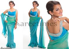 Riiti Fashions- diamond and crystal embellished blouse paired with a shimmer georgette saree