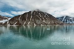 Clouds over the mountains along the Magdalenafjord in Svalbard islands, Norway