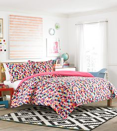 This Kaleidoscope Comforter Set from the Teen Vogue bedding collection will make you see your room from a new perspective.