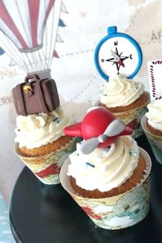 Travel the world with this vintage airplane birthday party! Love the cupcakes! See more party ideas and share yours at CatchMyParty.com #catchmyparty #partyideas #airpalnes  #airplanecupcakes #airplaneparty #boybirthdayparty #travel