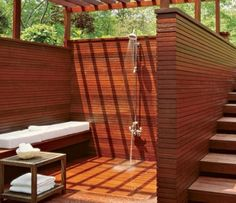 Outdoor shower enclosed with wood -