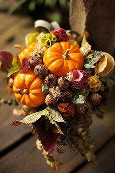 a rustic fall wedding bouquet with pumpkins, leaves, acorns and even fruit plus dried foliage - Weddingomania Fall Bouquets, Fall Wedding Bouquets, Bride Bouquets, Flower Bouquet Wedding, Floral Bouquets, Pumpkin Bouquet, Fruits Decoration, Vegetable Bouquet, Alternative Bouquet