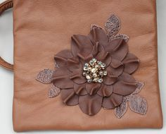 Leather wristlet, brown flowers and leaves with glass beaded center on Etsy, $48.00