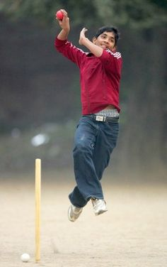 A boy from Pakistan playing cricket