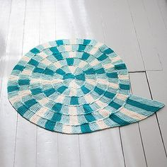 "Free knitting pattern for Spiral Bath Mat  This Sea Snail Bath Mat by Joyce Fassbender for Knit Picks is knit in a spiral from the inside out. The spiral is shaped with short rows and is joined as you knit. 22"" diameter. Great with multi-color or self-striping yarn!"