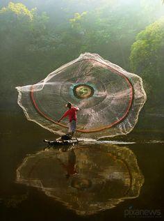 Casting his net in the Amazon jungle.