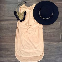 Suede high-slit top This beige suede top is so on trend! Pair it with leather leggings or ripped black skinny jeans. Has an open back and side slits. No trades. Price is firm. If interested, do not purchase this listing. I will make a new one for you. Sizes available: S, M, L Tops