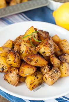 Greek Style Roasted Potatoes - crisp on the outside and with a creamy center! Naturally vegan and gluten-free.
