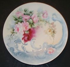 Antique porcelain hand painted plate.  Beautiful addition for a China Cabinet.