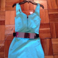 """BNWT teal dress with a slit in the rear areaSALE Very sexy dress with a deep bust area and a belt to go around the waist area to give off more of a sexier look...too small for me """"reduced"""" Dresses"""