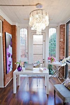 Brick walls, light, oversized windows, crystal chandelier - home office space