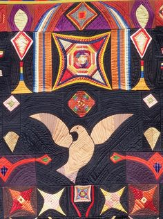 Close-up of dove, quilt by Carl Klewicke - 1907 from the American Folk Art Museum