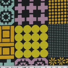 Designer Ellen Luckett Baker introduces Stamped, a graphic collection of prints that mix and match beautifully! Fun, graphic motifs are printed on a cheater print. Each square measures approximately 6