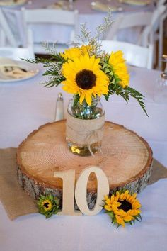 Gather inspiration for a beautiful summer decoration with sunflowers! table decoration wedding summer sunflower vase wooden disc STEP-BY-STEP INSTRUCTIONS and PHOTOS to Knit a Bunny from a S. Sunflower Wedding Centerpieces, Sunflower Arrangements, Blue Centerpieces, Wedding Table Centerpieces, Centerpiece Ideas, Sunflower Decorations, Wedding Flowers, Table Wedding, Centerpiece Flowers