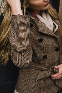 brown herringbone coat.