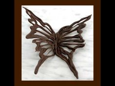 "Make a beautiful chocolate butterfly for a cake, confection, or dessert embellishment . Tutorial from The Chocolate Addict instructional chocolate decorating DVD "" The Chocolate Garden"". available at http://www.thechocolateaddict.com/"