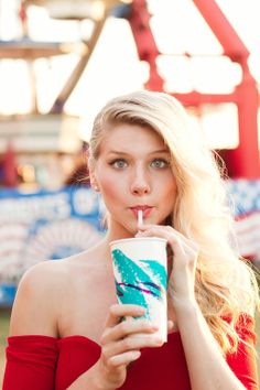 Try this cute senior session idea! Have your senior photos taken at the fair. Use some of the props such as sipping on a soda or posing with the giant stuffed animals. Your image will be full of color and of course, you! Poetic Edge Photography: Senior portraits, lifestyle, headshots in Charlotte NC