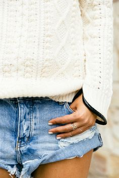 ivory cunky knit sweater with cutoffs