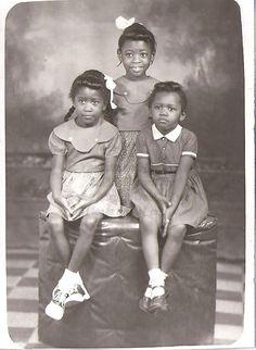 Three little black girls.