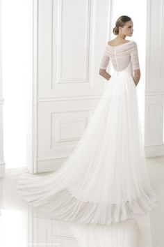 Pronovias 2015 lace cap-sleeve gown with an illusion-beaded back. Pronovias long-sleeve wedding dress featured a removable chiffon train, while a strapless