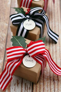 GIFT WRAPPING WITH BROAD STRIPED RIBBONS IN RED/WHITE & BLACK/WHITE & HOLLY LEAVES