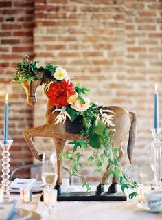 Equestrian-themed baby shower décor with small floral arrangement