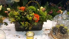 """Natural textured centerpiece--created by """"WOW"""" Event Design & Coordination with trick moss, alstroemeria, roses and eucalyptus. Great way to bring in the 2017 trend of natural touches."""