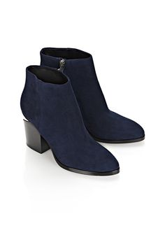 A staple addition to your footwear collection, these blue Gabi boots from Alexander Wang give a nod to the label's signature style. Crafted with a suede upper and sturdy sole, this mid-heel pair features a cut-out heel and covered metal zip fastening. Wear yours with tucked-in skinny jeans and a fur-trimmed parka.