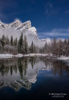 Three Brothers reflected in the Merced River on a moonlit night, Yosemite NP, CA, USA.  Michael Frye.