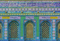 The tiled facade of the Dome on the Rock. The tiles were added as part of the redecoration of the building ordered by Sultan Suleyman who sent a group of tile-makers from Istanbul to Jerusalem. The cut-tile inscription at the top of the drum has the dates 952 AH/AD 1545-6 and the inscription above the north porch has the dates 959 AH/AD 1551-2.