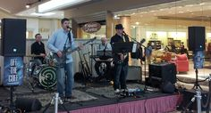 "The band ""Off The Cuff"" performing at the grand opening of our new store in the Eastern Hills Mall!"