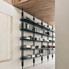 Jack is a system of bookcases that from floor to ceiling, with exceptional elegance and technological perfection, furnish the living or the contract environments. Designed by Michael Anastassiades for B&B Italia.  #bebitalia #jack #furnituredesign