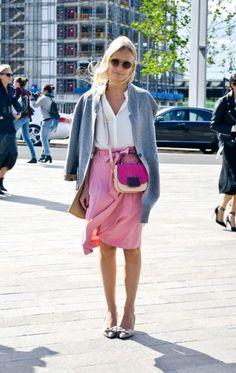 Pink wrap skirt and demure kitten heels.