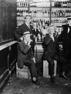 """A Photo of a Speak-Easy from around 1932.  The term """"speakeasy"""" might have originated in Pennsylvania in 1888, when the Brooks High-License Act raised the state's fee for a saloon license from $50 to $500. The number of licensed bars promptly plummeted, but some bars continued to operate illegally. Kate Hester had run a saloon for years just outside of Pittsburgh. She refused to pay the new license fee and wanted to keep from drawing attention to her illegal business. When her c"""
