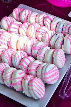 Strawberry Oreo's dipped in white chocolate then drizzled with pink icing.