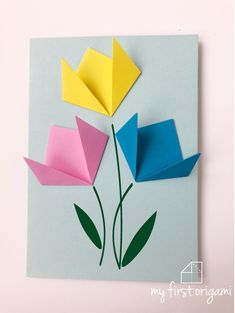How to get children folding EASY ORIGAMI TULIPS. A great starting origami with only a few steps.